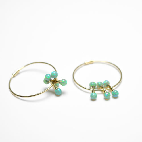 Neo hoops in yellow gold with green opals